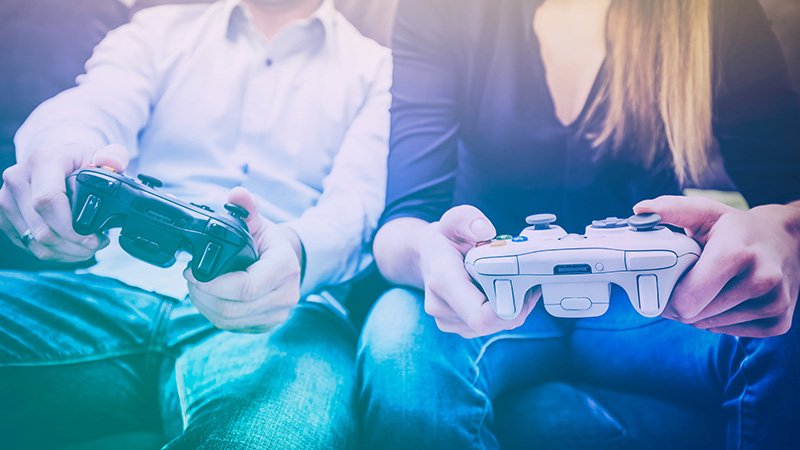 gaming game play fun gamer gamepad guy pad player girl controller online video closeup sitting focus console person concept - stock image